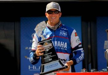 Patrick Walters of Ladson, S.C. hoists the Bass Pro Shops Bassmaster Central Open trophy after winning the event June 16, 2018.