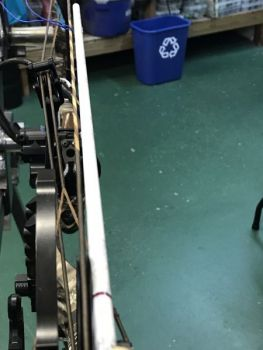 Check wheel alignment with an arrow shaft.